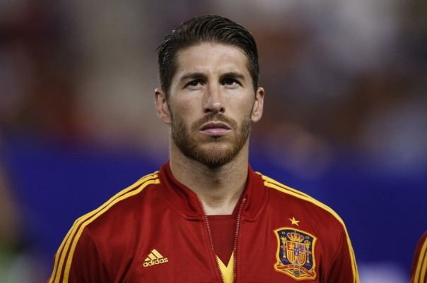 Spain's player Sergio Ramos listens to the national anthem prior a 2014 World Cup Group I qualifying soccer match between Spain and Georgia at the Carlos Belmonte stadium in Albacete, Spain, Tuesday Oct. 15, 2013. (AP Photo/Fernando Bustamante)